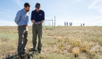 Photo of two people surveying a site for solar resource